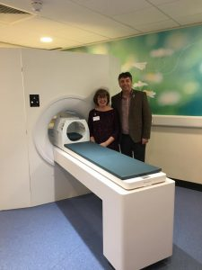 Pam and Mike stood in front of the mock scanner